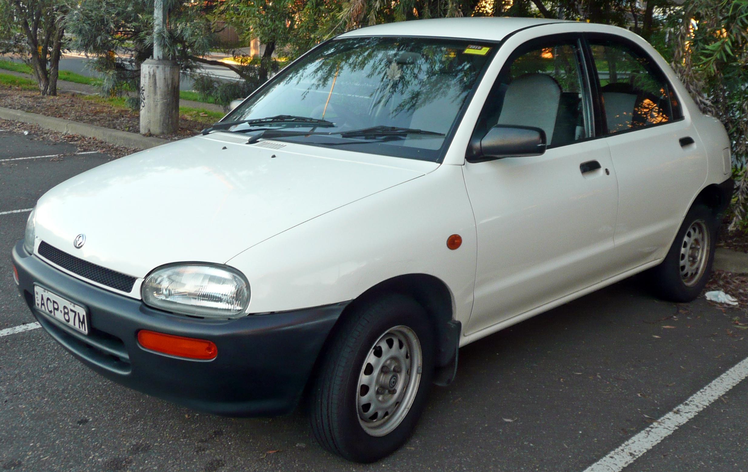 1994_Mazda_121_(DB_Series_2)_1.3_sedan_(2009-06-06)
